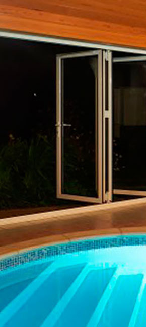 tall smarts aluminium bifold door with pool night